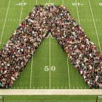 The freshman class posing for a picture in the shape of a W